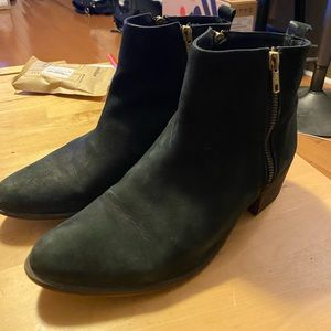 Black booties with gold zippers